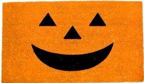 """Pumpkin Face Doormat by Abbott Collection. $28.00. This traditional jack-o-lantern face doormat makes your door ready for Halloween in an instant! Not too spooky, just a big grin that youll put out to welcome trick-or-treaters every year. This rubber-backed coir construction mat measures 17""""x 29 x 58. Mat is durable, fade resistant and cleans easily with hose or sponge. It lies perfectly in place and is ideal for swinging doors that require low clearance."""