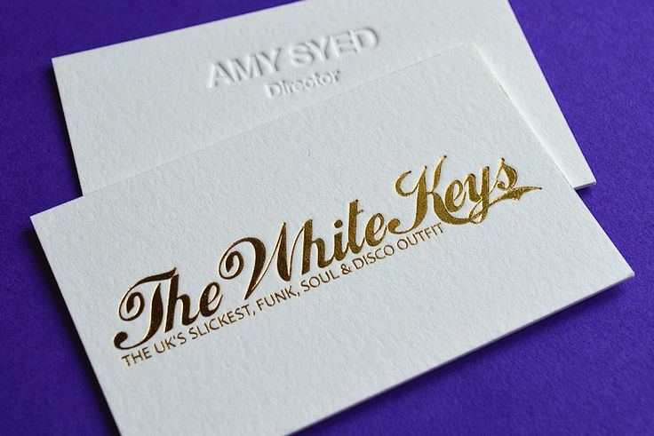 Debossed business card finished with metallic gold foil and silver