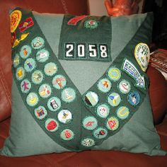 Girl Scout sash turned into pillow. Ignore the desire to improve the stitches u made when u were 11 years old.