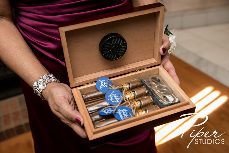 Gift for the Groom - 5 Cigars, carefully labelled. Each one signifying a specific milestone in the couple's life. Three were given by the groomsmen, one by his parents, and one by his new wife during our wedding speech. Each groomsmen said something about how they hoped to be involved in that specific milestone.