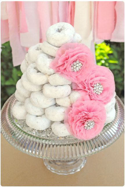 donut cake with pink vintage rosettes brunch girl birthday. my niece would love this.