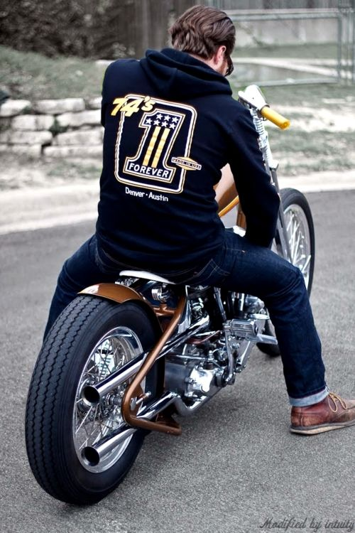 brown big twin custom with loop-tail frame and exhaust routed between rear wheel and frame