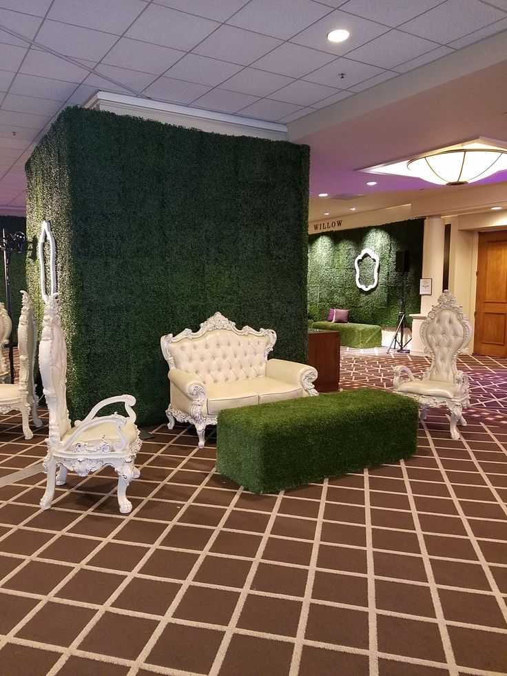 Green hedge walls for the lounges at Fred Hutch Holiday Gala 2016. Plus white soft seating and picture frames and you have a glam lounge!