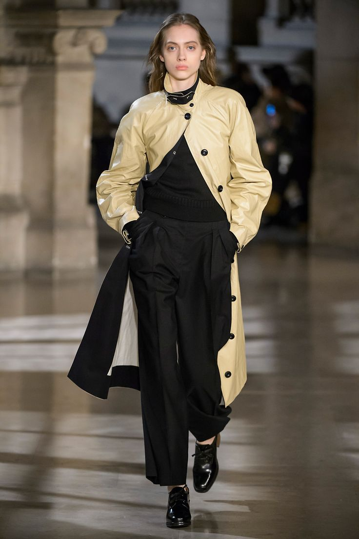 6. Overcoat in coated cotton, guernesey sweater in pure new wool, two-pleated pants in virgin wool, heeled oxford in leather