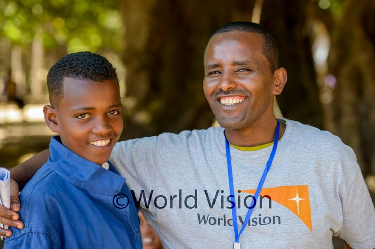 World Vision manager, Girma Zenebe, with a student from