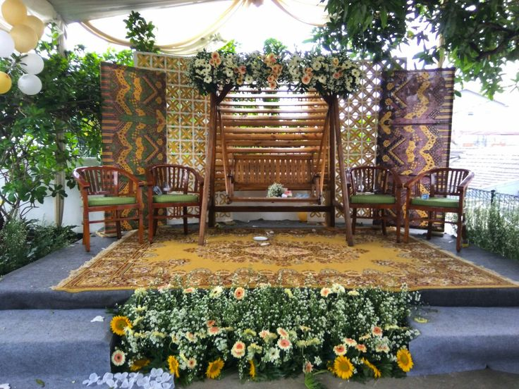 DIY inspiration for rustic wedding.. it located in our yardhouse.. made two panels of Batik, two panel of carved styro and using our wooden swings decorated with flowers and pillos..