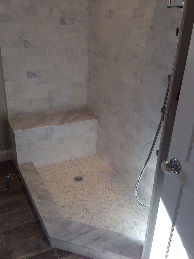 carrara marble subway tiles hexagon shower floor tiles and slabs for curb and bench in master bathroom this is a similar combo to what i envision