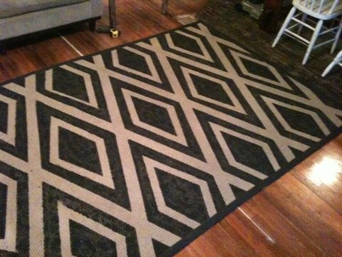 I HAVE to do something like this soon.  I've been looking for a living room rug forever, and this would solve the problem.