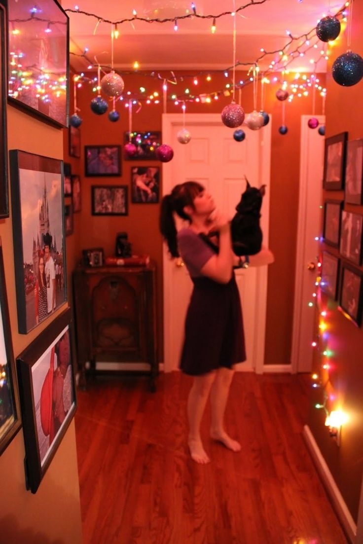 Hang ornaments from your ceiling (or from lights hung from your ceiling) so you don't have to give up any floor space. Sure, it may have a bit of a Stranger Things vibe, but not everyone has the same taste! (Personally... I'm really into it.)