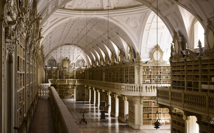 """The Telegraph listed the """"The most spectacular libraries in the world"""" and 2 of them are Portuguese: The Library of of the University of Coimbra (slide 1) and Mafra Palace Library (slide 4) 19/10/2013 #Portugal"""