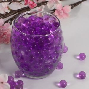 "Create glimmering floral or candle arrangements at your celebration with Ruby Blanc's ""Magic Pearl Jelly"" Purple Vase Filler. This easy-to-use product adds stunning color and serves as a non toxic/biodegradable filler for your favorite vases. Also, made of Bio-Gel, it contains all the nutrients necessary for plants and cut flowers to remain healthy and hydrated."