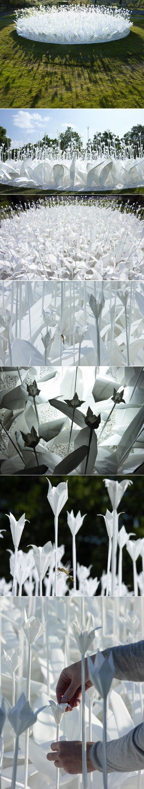 """Fold For Peace"" in Japan by swiss designer, Anouk Vogel. According to ancient Japanese legend, anyone who folds a thousand origami cranes is granted a wish by a crane. Anouk Vogel uses a lack of color to catch the eye and to represent peace."