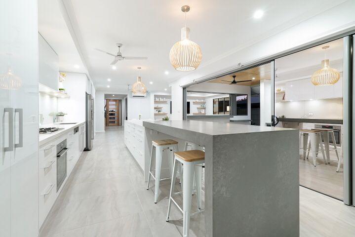 Essastone Concrete Pezzato breakfast bar, Essastone Pure Cloud Island & Back Bench with Laminex Polar White Silk Cupboards
