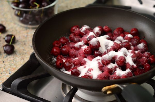Preparing a wonderful dessert: Cherries Jubilee