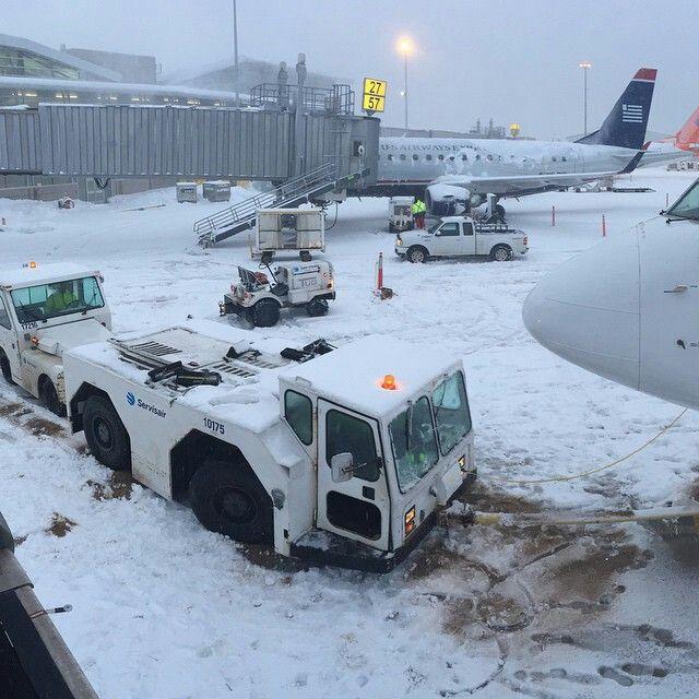 Servisair pushback tractor needing a push on the iced ramp to move back an Air Transat B737, Halifax Airport @jorgito_col