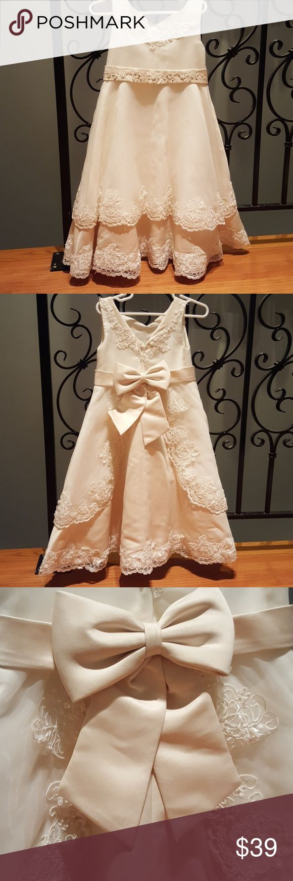Flower girl special occasion dress Beautiful special occasion dress.  The top layer of the dress is off white and the bottom is beige.  The back has a cute bow.  The dress has a very tiny stain that is only visible if you stare at it (see the last picture). Cinderella Dresses Formal
