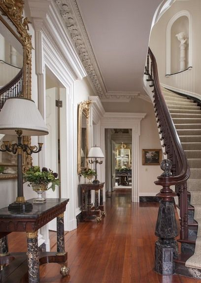 FOYER – great example of an impressive way to welcome guests with interiors traditional room staircase.