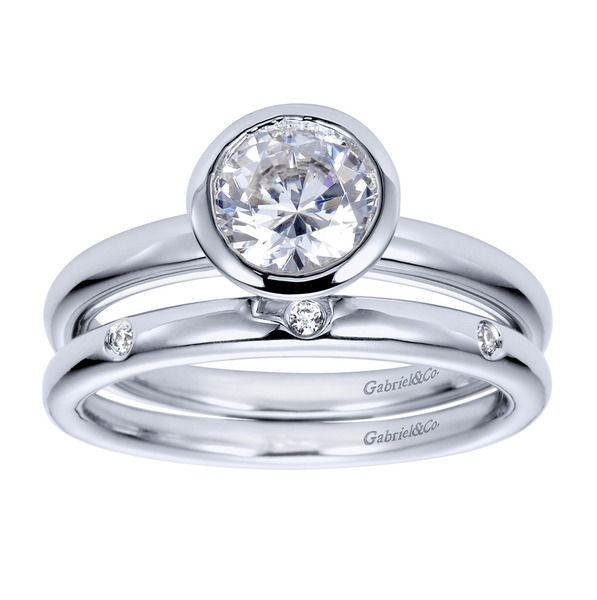 Gabriel & Co. - Our beautiful bezel set engagement ring has three diamonds in the wedding band.