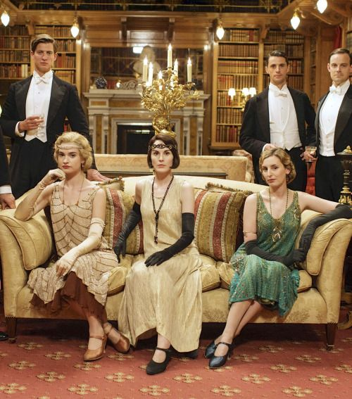 Lily James as Lady Rose Aldridge, Michelle Dockery as Lady Mary Crawley and Laura Carmichael as Lady Edith Crawley in Downton Abbey (Series 5 Christmas Special, 2014).