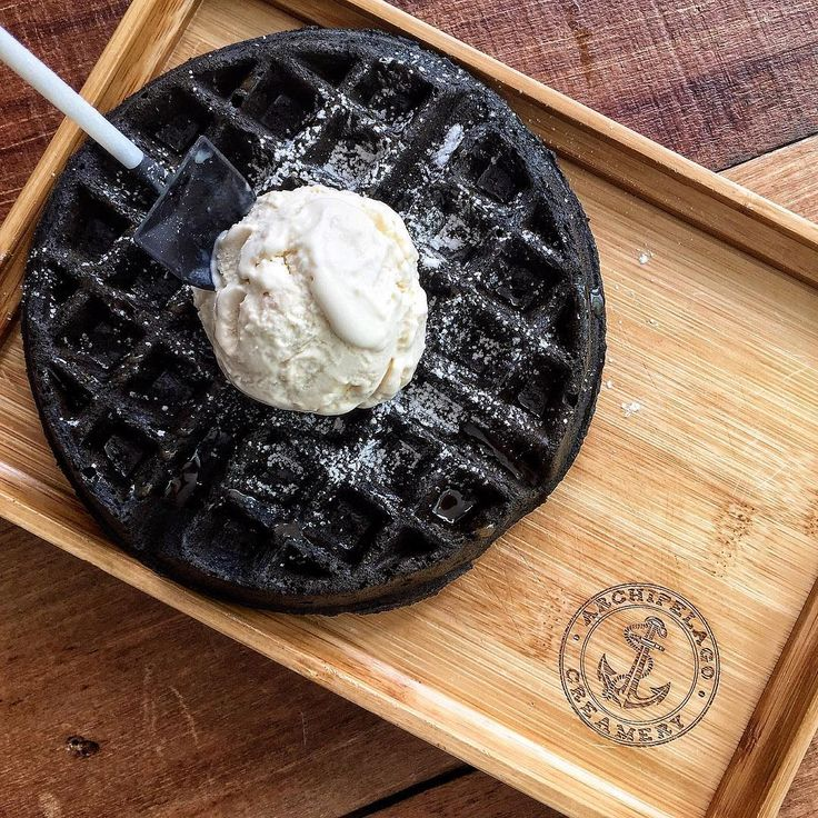 Black charcoal waffle with premiere earl grey ice cream.