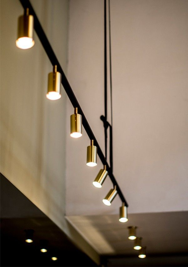 Striking and simple suspended track lighting with brass pendants and  fittings | interior design; decoration; lighting design; decor; hopmewares;