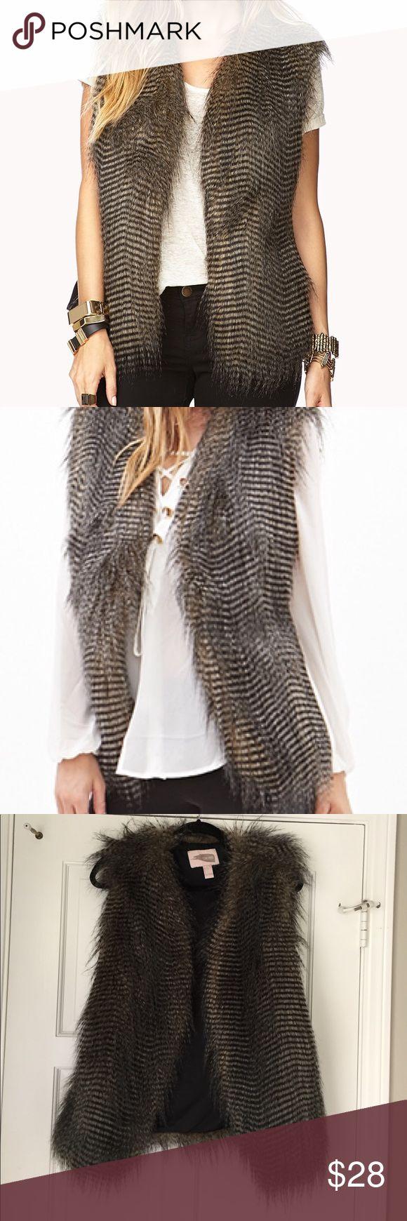 Faux fur vest in  brown Faux fur vest in brown. Knit side panel Forever 21 Jackets & Coats Vests