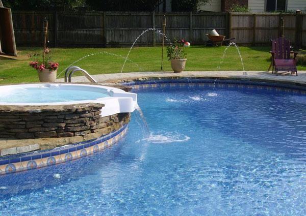 20 Tolle Designs Für Einen Wasserfall Am Swimming Pool