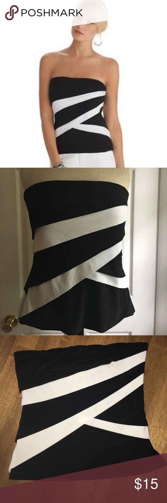 """White House black market black & white tube top White House black market black and white striped tube top, fully lined with stay strip to help hold in place, no straps, side zip with hook closure, 17"""" across bust, 15"""" at waist and 17"""" across hem, 17""""in length. Excellent condition. White House Black Market Tops"""