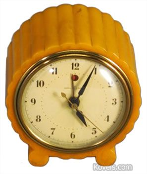 Bakelite Alarm Clock: This 4 1/4-inch orange Bakelite clock was made by General Electric and sold for $360 at a Rago auction <3