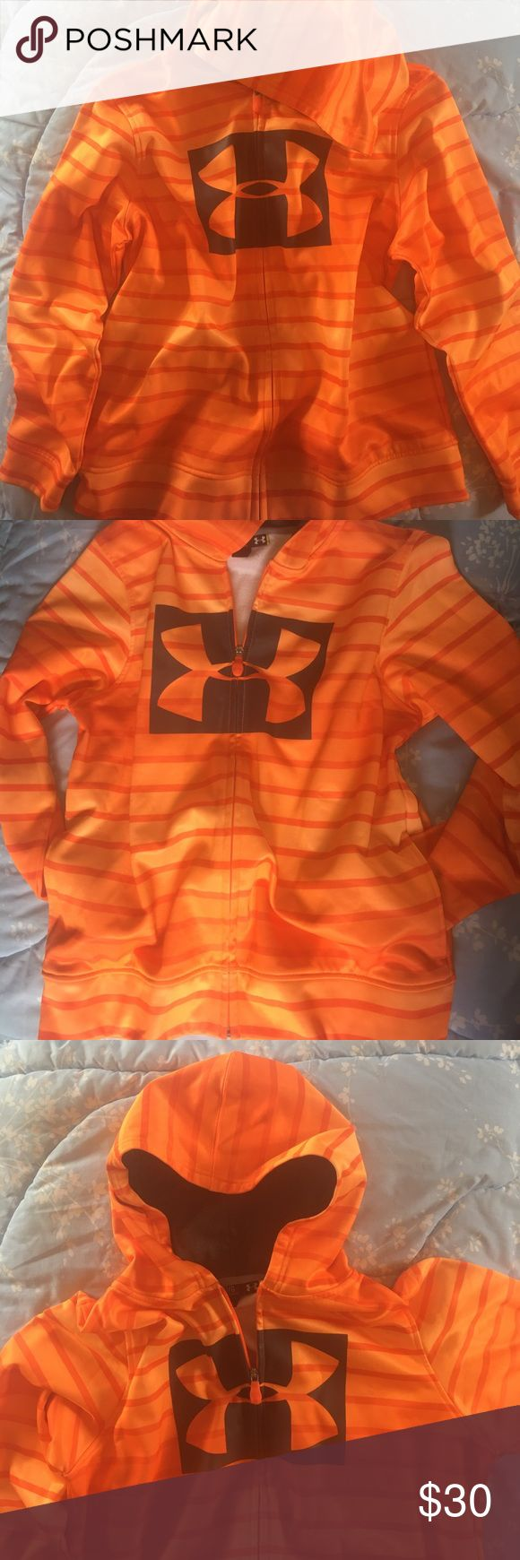 Under Armour zip-up jacket Youth Large Excellent condition Neon orange Under Armour zip-up jacket, size youth large. Has two almost non existent tiny dots (pictured above) on the back at the very bottom, otherwise like new condition. Can also fit a small adult or a small/medium adult woman.                                                                           🚭 and 🐶🐱 free home Under Armour Jackets & Coats