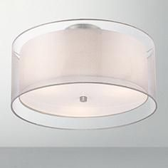 A white hardback inner shade is enclosed by an elegant silver organza fabric outer shade in this double drum ceiling light for a captivating effect.