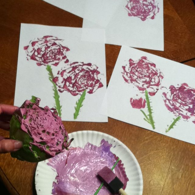 Kid friendly lettuce art!  After cutting the ends of romaine lettuce use the chunk to make flowers!
