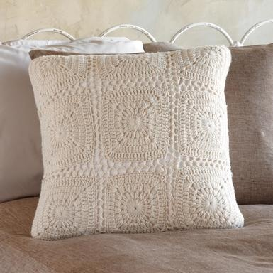 Really like this solid crocheted pillow. Would look pretty in a linen yarn!