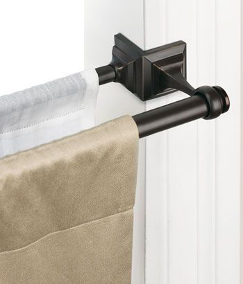 How brilliant is this? You can put up a tension rod and it doesn't have to be ugly!!!! You can even use two different curtains. Double Spring Tension Rod
