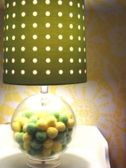 Love this fun pom-pom lamp from @HomeGoods - could easily do a similar DIY!