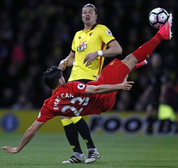Liverpool's German midfielder Emre Can connects with this overhead kick to open the scoring in the English Premier League football match between Watford and Liverpool at Vicarage Road Stadium in Watford, north of London on May 1, 2017. / AFP PHOTO / Adrian DENNIS / RESTRICTED TO EDITORIAL USE. No use with unauthorized audio, video, data, fixture lists, club/league logos or 'live' services. Online in-match use limited to 75 images, no video emulation. No use in betting, games or single…