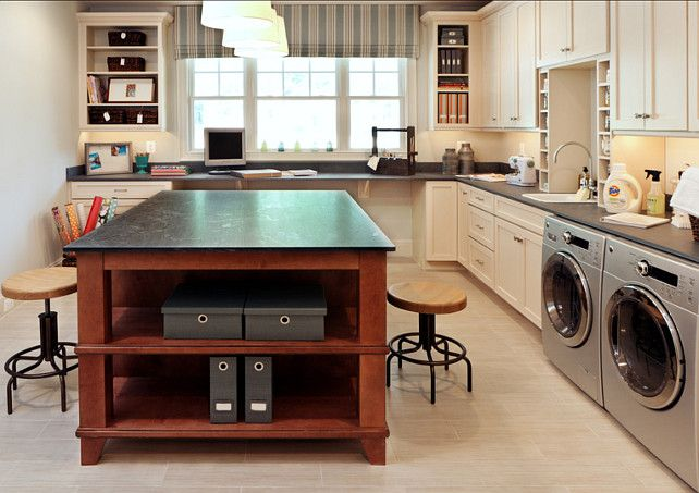This laundry room doubles as a craft room. It was created to have a large place for folding as well as a large space for craft or art work in progress. The stools are from Universal Furniture and the countertop material is slate and it is the same top on perimeter and island.