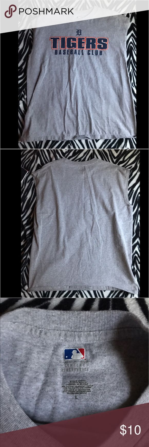 Detroit Tigers Muscle Tank Men's size Large Detroit Tigers Muscle Tank. Grey with the official MLB colors of the Detroit Tigers baseball team. No flaws. MLB Shirts Tank Tops