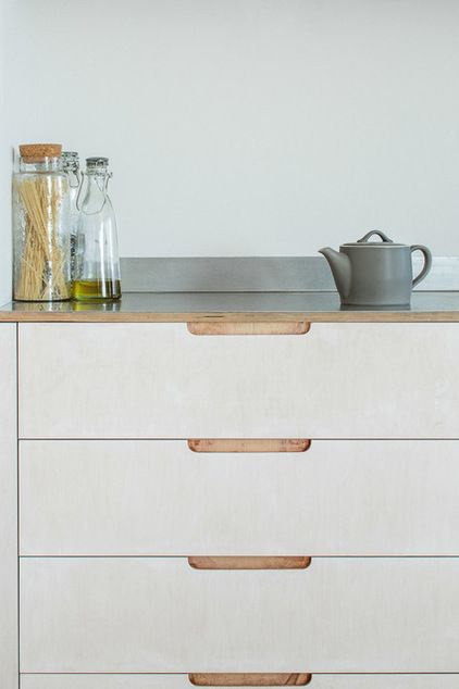 "Scandinavian by Sustainable Kitchens ""The door and drawer fronts were treated with lye to lighten them. It gives them a lovely soft, chalky feel,"" Shaw says. ""But the end grain and the recessed handles were left natural for contrast. The plywood was all sealed with an ecofriendly, water-based matte lacquer."