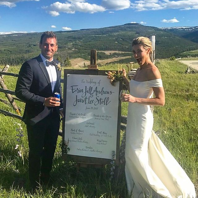 Erin Andrews and Jarret Stoll Wedding Photo - Erin Andrews looks thrilled as she and Jarret Stoll pose next to a sign listing the responsibilities of their bridal party.