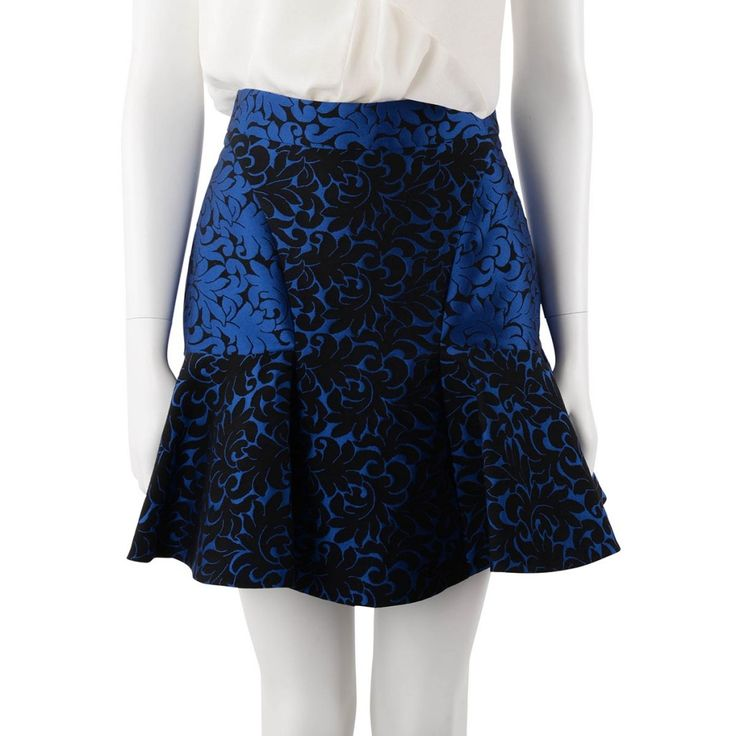 The Stella McCartney Patty Brocade Mini Skirt. From Fall 2012 comes this cobalt blue and black brocade panel skirt. A bright fun, bold piece easy to work back with black for a smart stylish look. ...