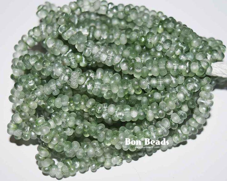 3x6mm Crystal Light Green Lumi Etched Farfalles @ www.bonbeads.com