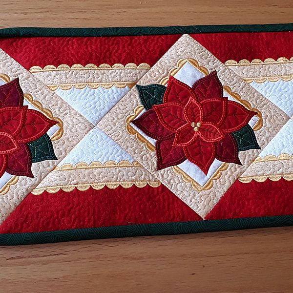 Quilted Poinsettia Table Runner 8211 Quilted Table Runners Patterns In 2020 Quilted Table Runners Patterns Machine Embroidery Quilts Quilted Table Runners Christmas