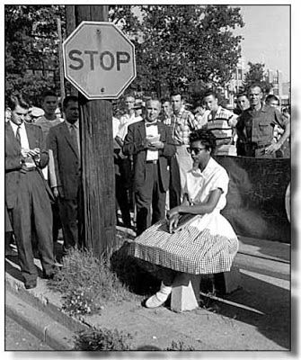 "1957 little rock nine  | Don't let her in our school,"" called out another."