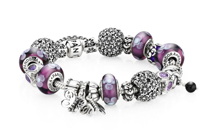 Purple indulgence with flower clips and the popular friendship butterfly charm. - Click the picture to design your own bracelet - Please note that some products on this picture may be discontinued or not available in your country of residence. For clarification, please contact PANDORA's customer service. Find the contact details at www.pandora.net. #pandora #pandorajewelry #pandorajewellery #silverjewelry #silver #jewellery #jewelry #pandorabracelet #charmbracelet #sterlingsilver #charms