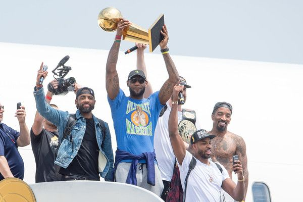 LeBron James Photos - Kyrie Irving #2, LeBron James #23, Tristan Thompson #13, Kevin Love #0 and J.R. Smith #5 of the Cleveland Cavaliers return to Cleveland after wining the NBA Championships on June 20, 2016 in Cleveland, Ohio. - 2016 NBA Champion Cleveland Cavaliers Airport Arrival