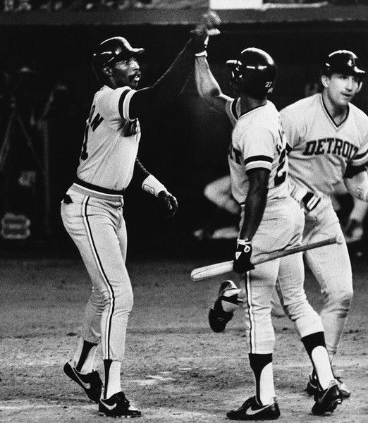 Game 1 WS - Detroit Tigers designated hitter Barbaro Garbey (center) congratulates Larry Herndon (left) after Herndon's fifth-inning two-run homer put the Tigers into a 3-2 lead over the San Diego Padres in the first game of the World Series at night, Tuesday, Oct. 10, 1984 in San Diego. Lance Parrish who was knocked in by Herndon heads for the dugout. The Tigers kept the lead to win the first game of the series, 3-2. (AP Photo)