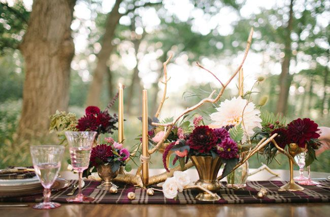 gold candlesticks and branches + a cluster of vintage tulip vases filled with lush florals, ferns, plum peppers, + blush berries.