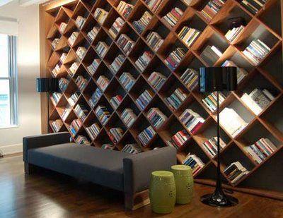 Slanted bookshelves. So cool!