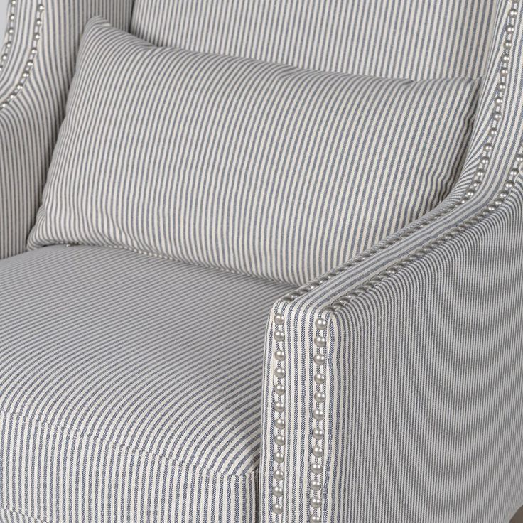 Armchair detail.  Chrome studs with traditional stripe . . . really beautiful.
